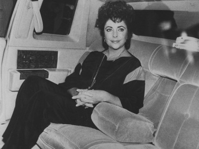 Actress Elizabeth Taylor Sitting in the Back of a Limo Stretched Canvas Print