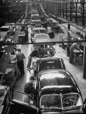 Cars Moving Down Assembly Line Stretched Canvas Print