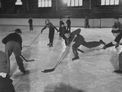 Schoolboys Playing Ice Hockey Stretched Canvas Print