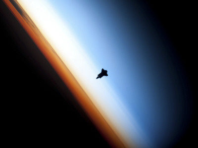 Silhouette of Space Shuttle Endeavour over Earth's Colorful Horizon Stretched Canvas Print
