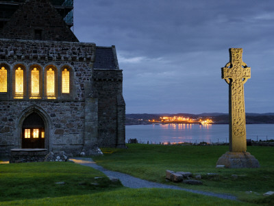A Celtic Cross Stands Outside the Iona Monastery Church at Dusk Stretched Canvas Print