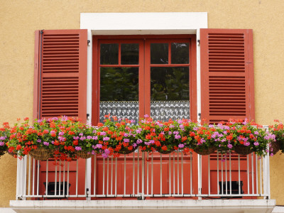 Pots of Geranium Flowers on Window Balcony Stretched Canvas Print