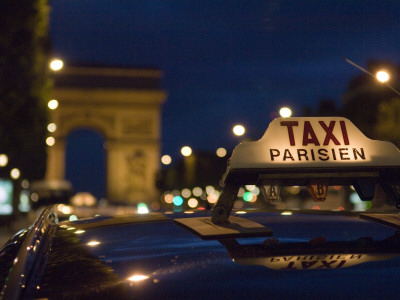 Taxi on Champs Elysees at Dusk Stretched Canvas Print