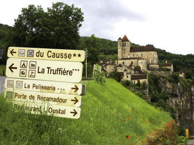 Tourist Signs Outside Village of St. Cirq Lapopie Stretched Canvas Print