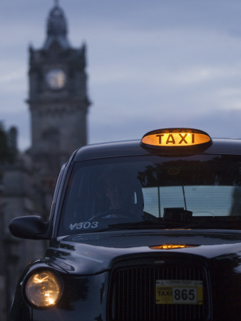 Taxi with Balmoral Hotel in Background Stretched Canvas Print