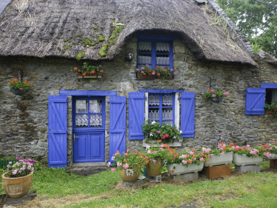 Thatched Cottage with Blue Doors, Windows and Pots of Geraniums Near Marzan Stretched Canvas Print
