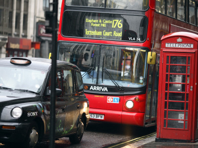 London Buses and Taxis in Heavy Traffic Stretched Canvas Print
