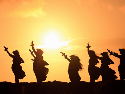 Silhouette of Hula Dancers at Sunrise, Molokai, Hawaii, USA Stretched Canvas Print