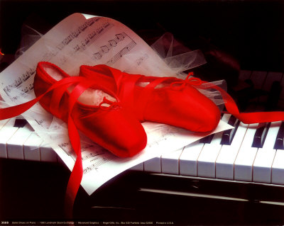 Red pointe shoes on piano