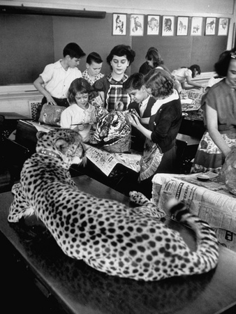 A Live But Tame Cheetah Models for Potter School Pupils as They Make a Mask Stretched Canvas Print
