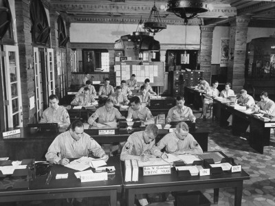 Soldiers at Work in an Army Office in What Was the Lobby of the Hotel Evans Stretched Canvas Print