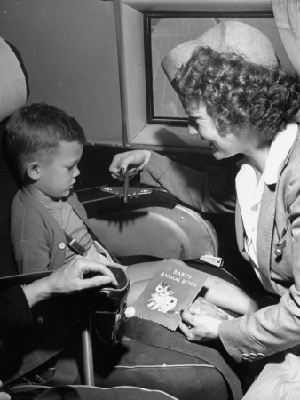 "Stewardess Tempting Little Boy with Model Airplane Aboard the United Airlines ""Nurseryliner"" Stretched Canvas Print"