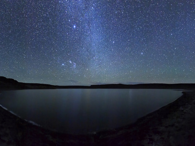 A Panoramic View of the Milky Way and La Azul Lagoon in Somuncura, Argentina Stretched Canvas Print