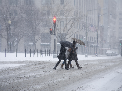 A Trio of Pedestrians Rush Through the 'Blizzard of 2010' Stretched Canvas Print