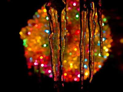 Rooftop Icicles Echo the Bright Colors of Christmas Lights Stretched Canvas Print
