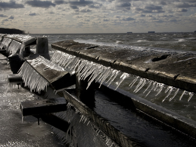 Windblown Icicles Coat a Pier on a Chesapeake Bay Winter Day Stretched Canvas Print