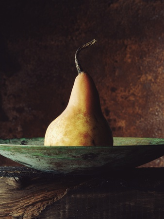 Single Pear in Bowl Stretched Canvas Print