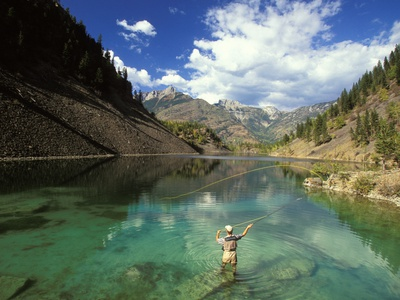 Young Man Fly-fishing on Lower Silver Springs Lake in the Elk Valley Near Fernie, British Columbia, Stretched Canvas Print