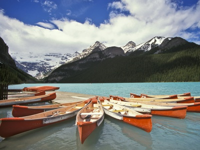 Canoes on Lake Louise Stretched Canvas Print