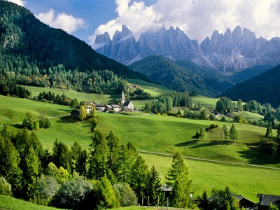 Santa Maddalena church in the Dolomites Mountains Stretched Canvas Print
