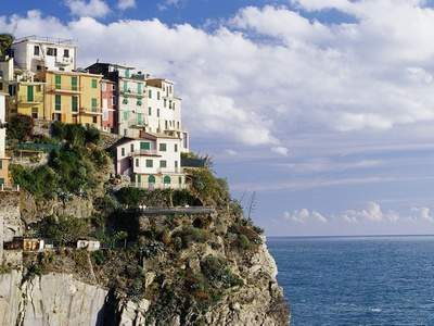 Houses on Sea Cliff in Manarola Stretched Canvas Print