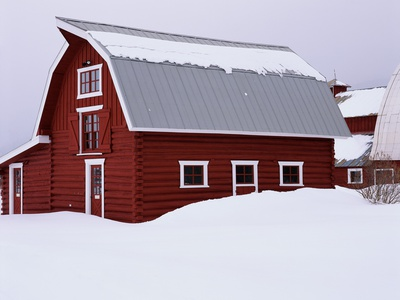 Red Barn in the Snow Stretched Canvas Print