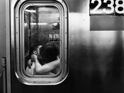 Passionate Couple Kissing in a Subway Car Stretched Canvas Print