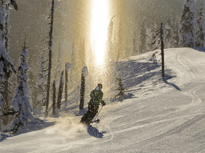 Skiing Through a Sundog on Corduroy Groomed Runs at Whitefish Mountain Resort, Montana, Usa Stretched Canvas Print