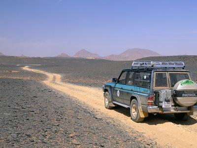 Jeep Driving on Stone Desert, Akakus, Sahara Desert, Fezzan, Libya, North Africa, Africa Stretched Canvas Print