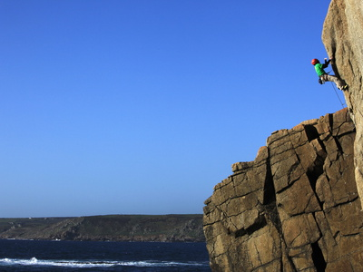 A Climber Tackles a Difficult Route on the Cliffs Near Sennen Cove, Cornwall, England Stretched Canvas Print