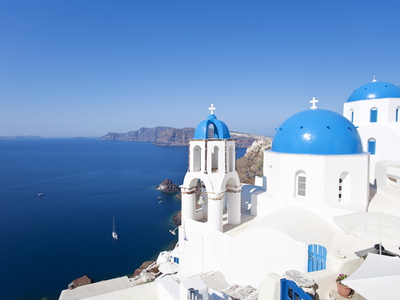 Blue Domed Churches in the Village of Oia, Santorini (Thira), Cyclades Islands, Aegean Sea, Greece Stretched Canvas Print