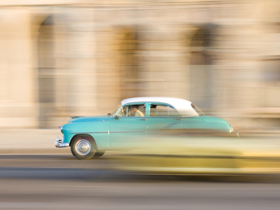 Panned Shot of a Classic American Car on the Malecon, Havana, Cuba, West Indies, Central America Stretched Canvas Print