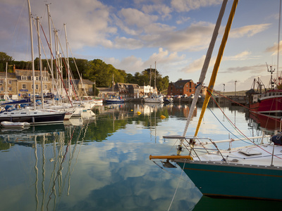 Low Morning Light and Sailing Yacht Reflections at Padstow Harbour, Cornwall, England, United Kingd Stretched Canvas Print