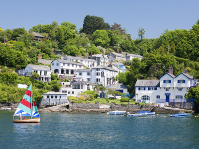 A Dinghy Sails Past the Village of Boddinick Near Fowey, Cornwall, England, United Kingdom, Europe Stretched Canvas Print