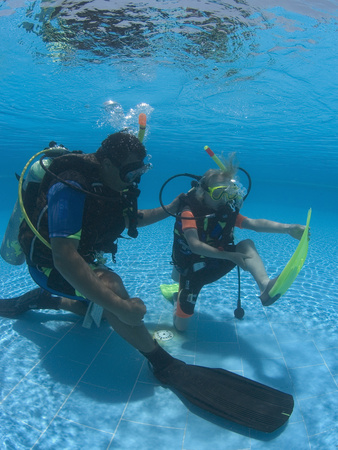 Young Girl Being Shown by Instructor How to Alleviate Cramp During Padi Junior Open Water Course Stretched Canvas Print