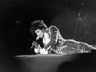 Prince, Lying on Stage During His Purple Rain Tour, 1984 Stretched Canvas Print