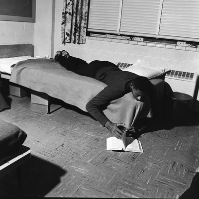 Basketball Great Wilt Chamberlain Relaxes with a Book, 1957 Stretched Canvas Print