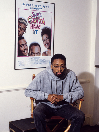 Filmmaker Spike Lee, Seated in Front of a Poster of His Film 'She's Gotta Have It', 1986 Stretched Canvas Print