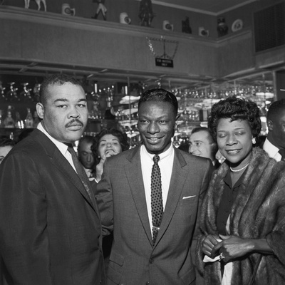 Nat King Cole Is Flanked by Boxing Great Joe Louis and His Wife Rose Morgan Stretched Canvas Print