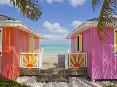 A Typical Tropical Scene with Colorful Buildings, Palms and Water Stretched Canvas Print