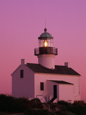 Lighthouse Against a Pink Sky at Twilight Stretched Canvas Print