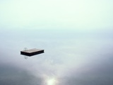 A Dock Appears to Hover in Mid-Air on the Placid Waters of Lake Thun