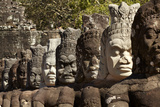 Row of Statues of Asuras on South Gate Bridge across Moat to Angkor Thom  Siem Reap