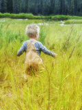 Alaska  2 Year Old Child Playing in Tall Grass  Summertime