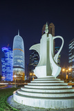 Qatar  Doha  Doha Bay  West Bay Skyscrapers  Dusk  with Large Coffeepot Sculpture