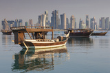 Qatar  Doha  Dhows on Doha Bay with West Bay Skyscrapers  Dawn