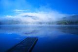 An Empty Dock on a Calm Misty Lake