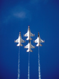 The Us Air Force Thunderbirds Climbing in a Tight Formation
