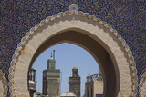 Africa  Morocco  Fes an Arch with Classic Moorish Decor Frames Two Minarets