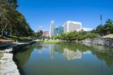 City Park Lagoon with Downtown Omaha  Nebraska  Usa